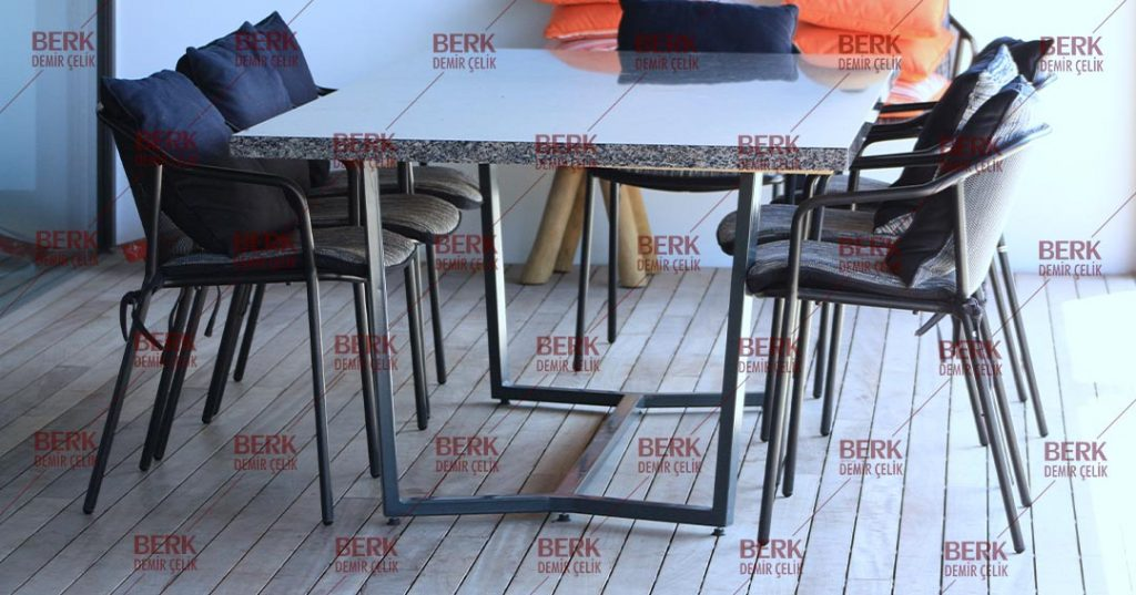 Decorative low table standing in the garden of a luxury house